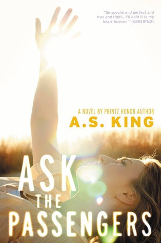 Book cover for Ask the Passengers by A. S. King showing teen girl with hand raised toward the sun